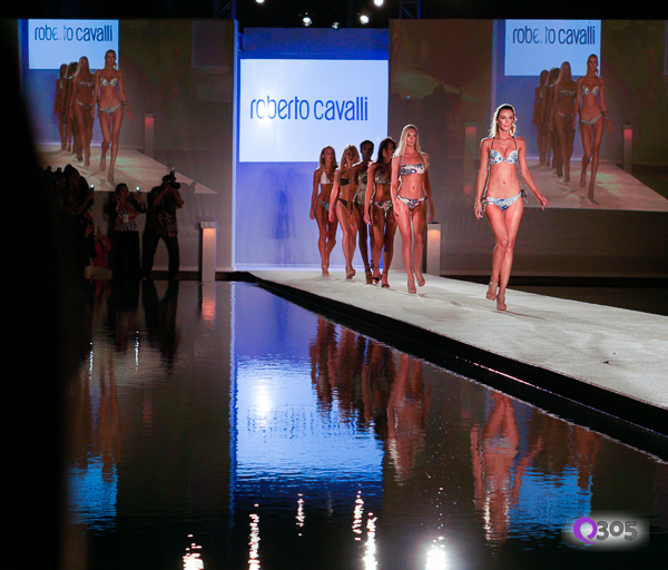 Models walk down the runway.