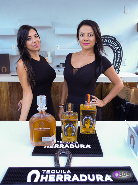 Models behind Herradura Tequila Bar.